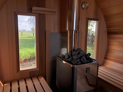 windows at the back of the sauna barrel
