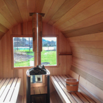 Extra large window behind the stove of the sauna barrel